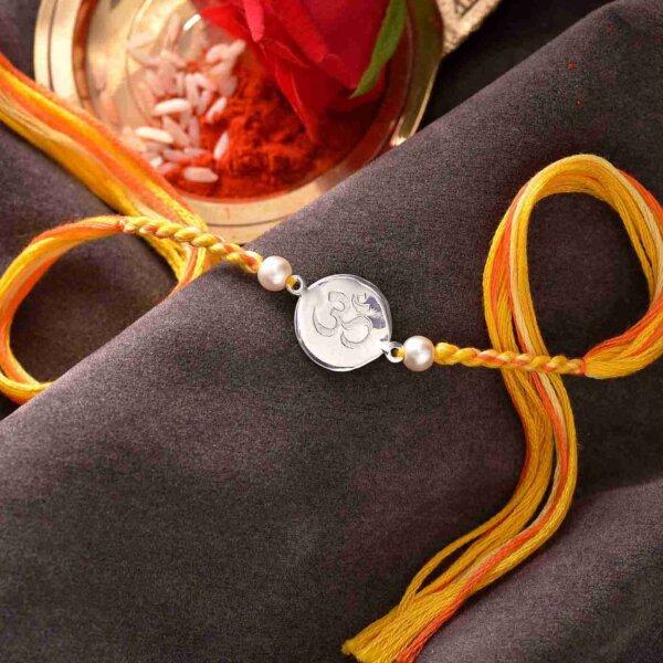 Silver OM Rakhi With A Multi-Toned Thread