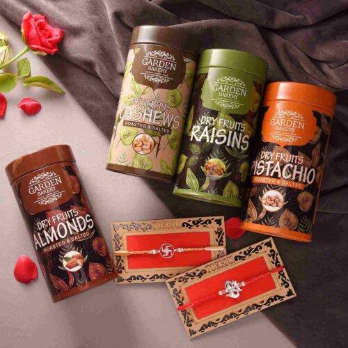 Set Of 2 Swastik & Designer Silver Rakhis With Set Of 4 Exotic Dry Fruit Cans