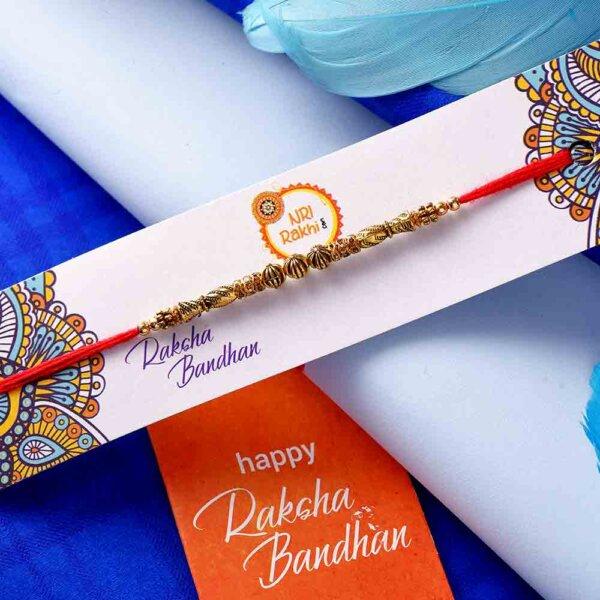 Golden Beads Rakhi