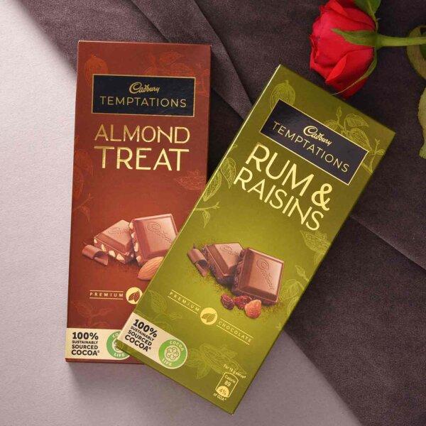Set Of 2 Designer Silver Rakhis With Cadbury Temptations Almond Treat and Rum & Raisins (72g each)