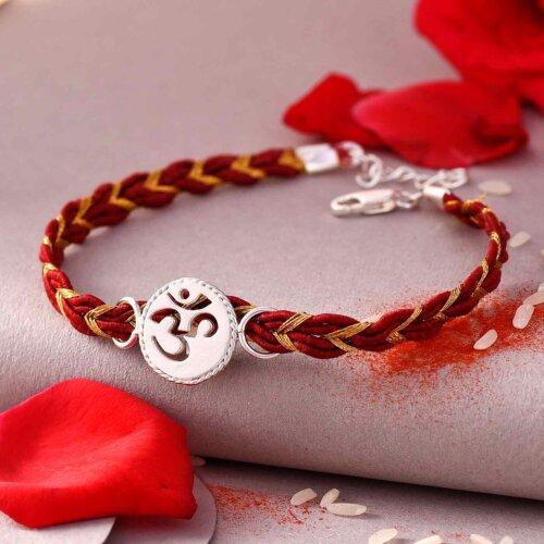 Silver & White OM Rakhi In Bracelet Style With Nutberry