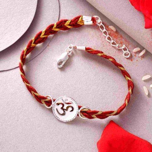 Silver & White OM Rakhi In Bracelet Style