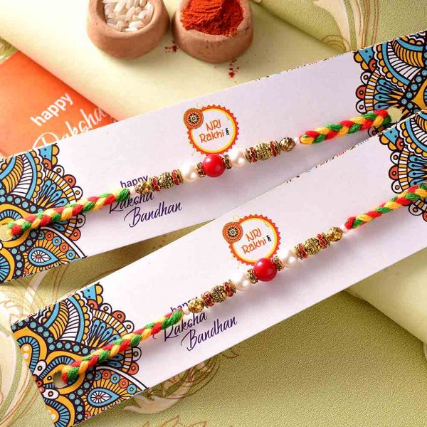 Pair of Red & White Pearls Rakhis With Interlaced Thread