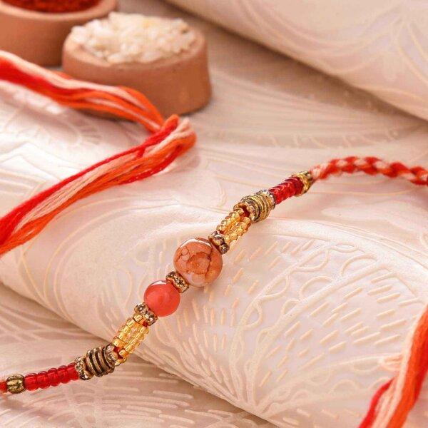 Orange Pearl Rakhi