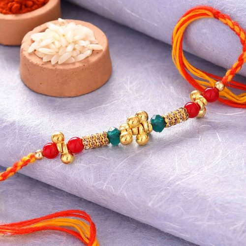 Colorful Pearls Rakhi With Golden Work