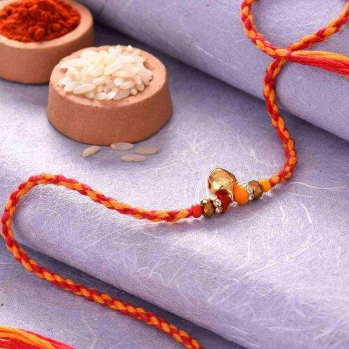 Elegant Rakhi With Golden Dangler