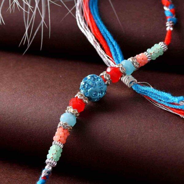 Big Blue Pearl Rakhi With A Triple-Toned Thread