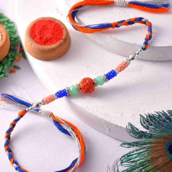 Orange Pearl Rakhi with Colorful Beads