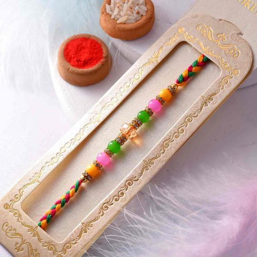 Colorful Pearls Rakhi With A Multi-Toned Thread