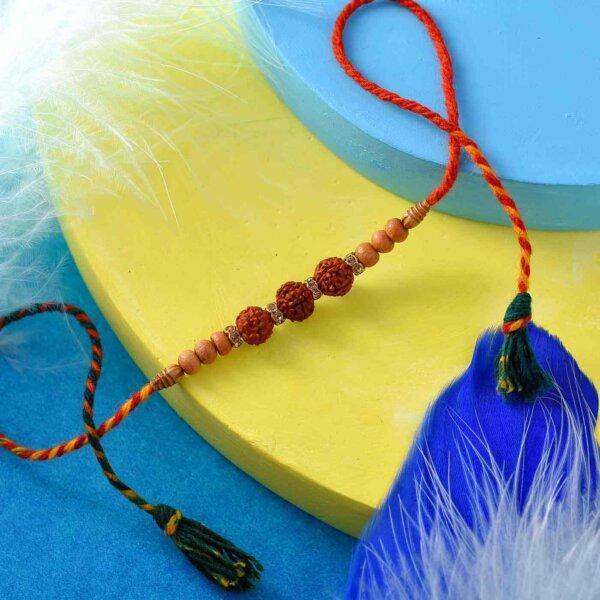 3 Beads Rudraksha Rakhi With An Interlaced Thread