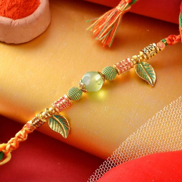 Green Pearl Rakhi With Twin Hanging Metallic Leaves