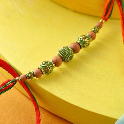 Green Pearl Rakhi With Golden Work