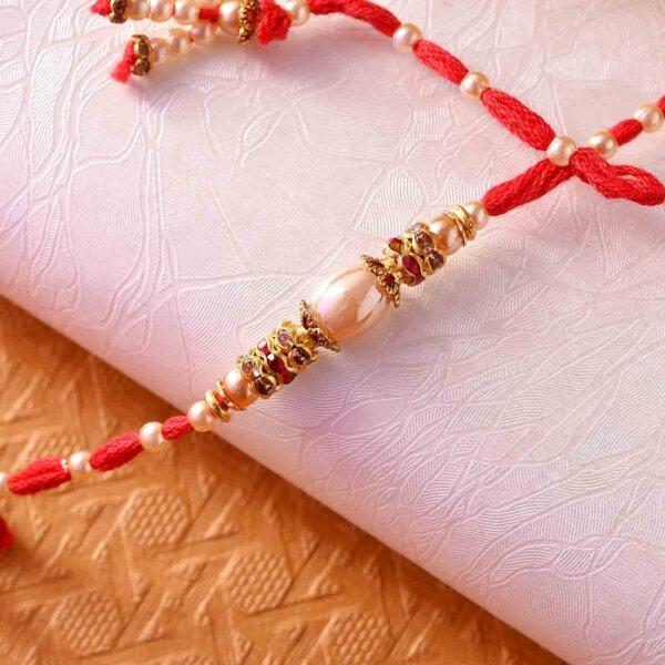 Metallic Gold Pearl Rakhi With Designer Thread