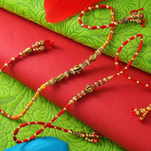 Set of 2 Metallic Work Rakhis With Decorated Thread