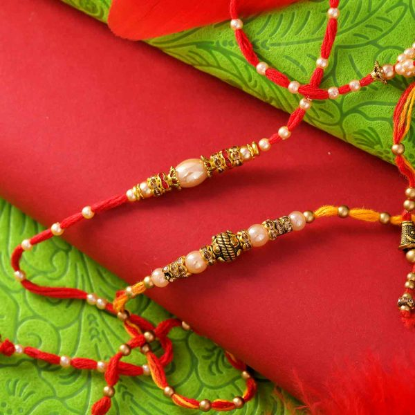 Set of 2 Golden Pearl Rakhis With Decorated Thread