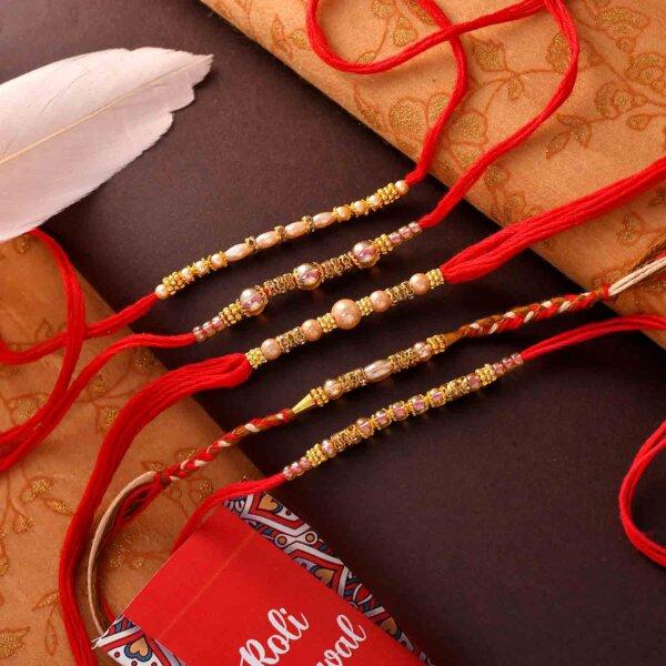 Set Of 5 Golden Beads Rakhis On A Red Thread