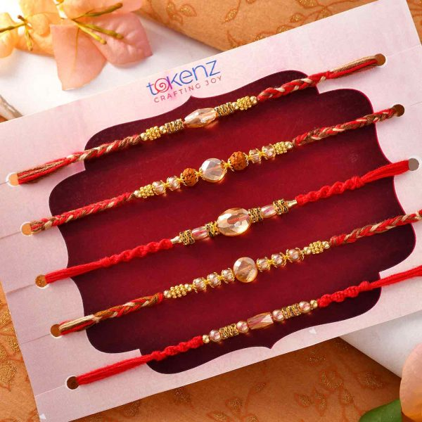Set Of 5 Golden Pearl Rakhis With Interlaced Thread