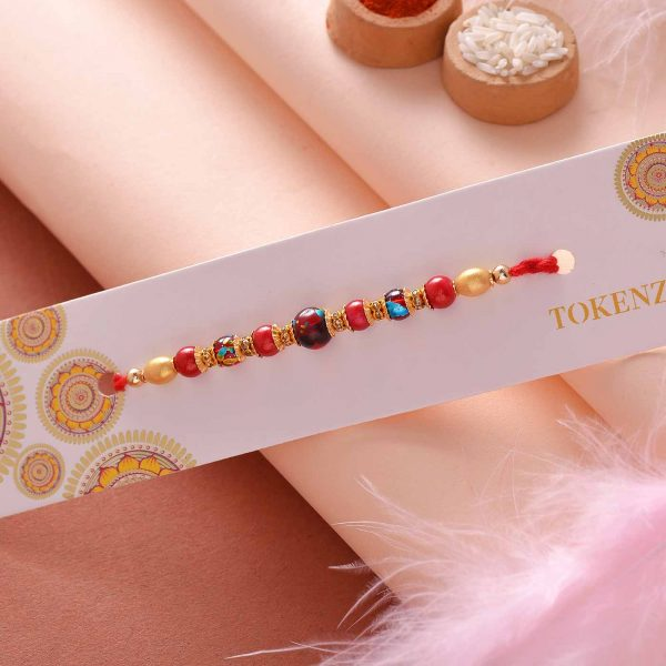Red Pearl Rakhi With A Silk Thread