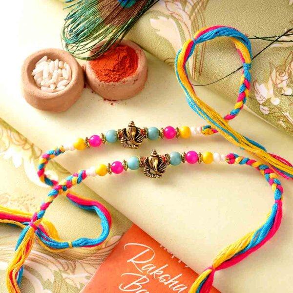 Enticing Ganesha Rakhi with colorful beads-Set of 2