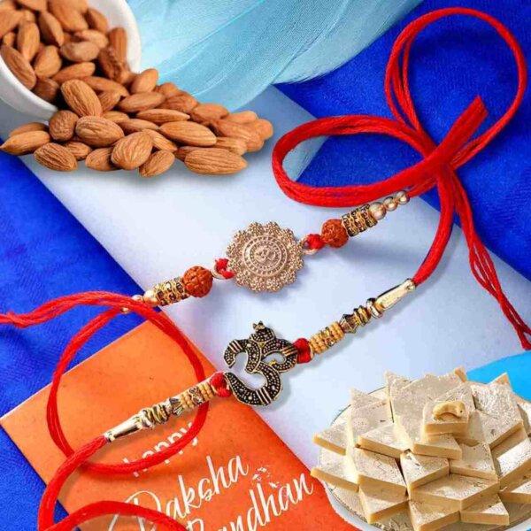 Om set of 2 rakhi with Almonds 113 Gm. and  Kaju Katli 225Gms combo