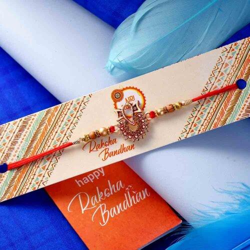 Ganesha rakhi with Natural Almonds 113 Gms and Wonderful Pistachio  84 Gms