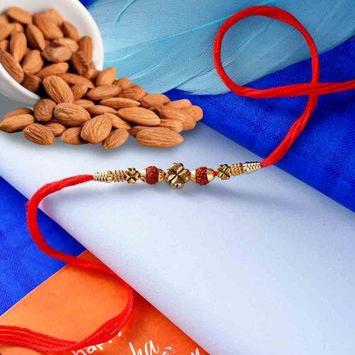 Artistic Rudraksha rakhi with Natural Almonds 113 Gms