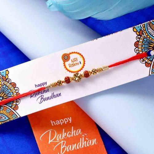 Rudraksha rakhi with  Kaju Katli 225Gms and Kirkland Dry Fruit Mix Box 1.13 Kg.