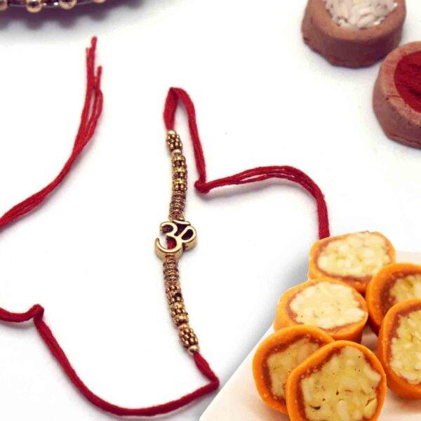 OM rakhi with  Pure Kaju Sweet Orange dryFruit Cassata  450 Gms