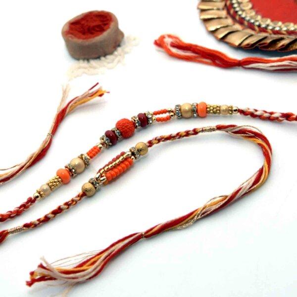 Pack of Panchamukhi Rudraksha Rakhi & Yellow & Red Small Beads Rakhi