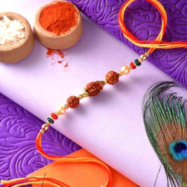 3 Rudraksha Seeds Rakhi In A Multi-Toned Thread