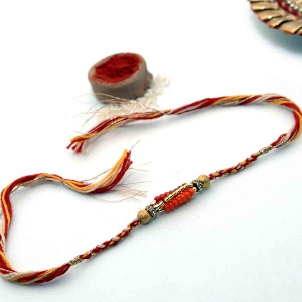 Small Golden & Orange Beads Rakhi