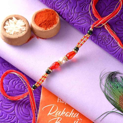 Silver Pearl Rakhi With A Dual-Toned Thread