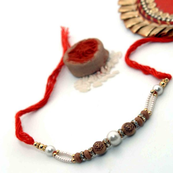 OM Rakhi With Silver Pearls