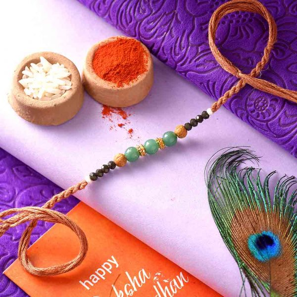 Blue & Black Beads Rakhi With A Brown Thread