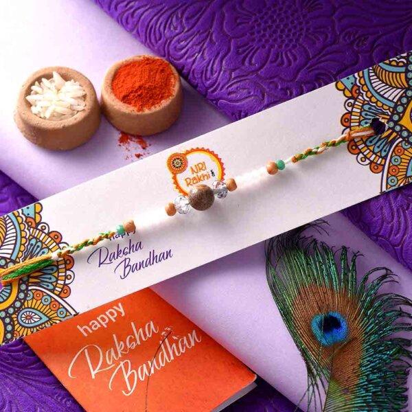 Brown Bead Rakhi With White Pearls