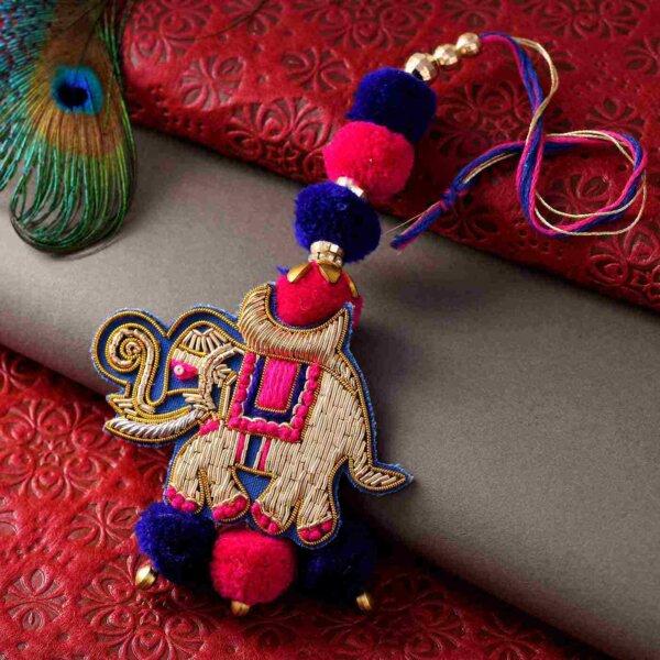Elephant Lumba  Rakhi in Zari and Pom-Pom Rakhi